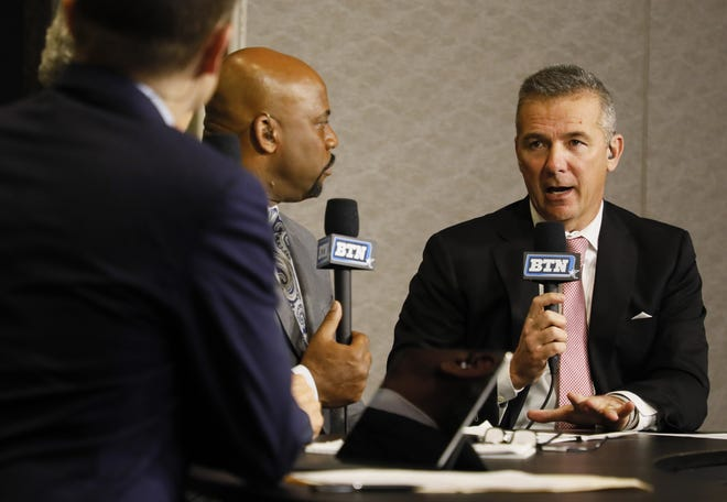 Former Ohio State Buckeyes head coach Urban Meyer talks while reporting for the Big Ten Network from Clemson Tigers Media Day at the College Football Playoff Semifinal at the PlayStation Fiesta Bowl on Thursday, December 26, 2019 at the Camelback Inn in Scottsdale, Arizona. [Joshua A. Bickel/Dispatch]