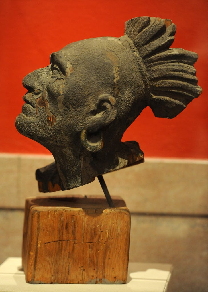 The wooden head likeness of Native American Squanto, which is the only surviving piece of the wooden pediment that was installed on the Pilgrim Hall Museum building in 1880.