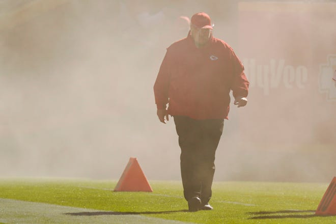 Kansas City Chiefs head coach Andy Reid walks onto the field during team introductions before a game against the New York Jets on Sunday in Kansas City.