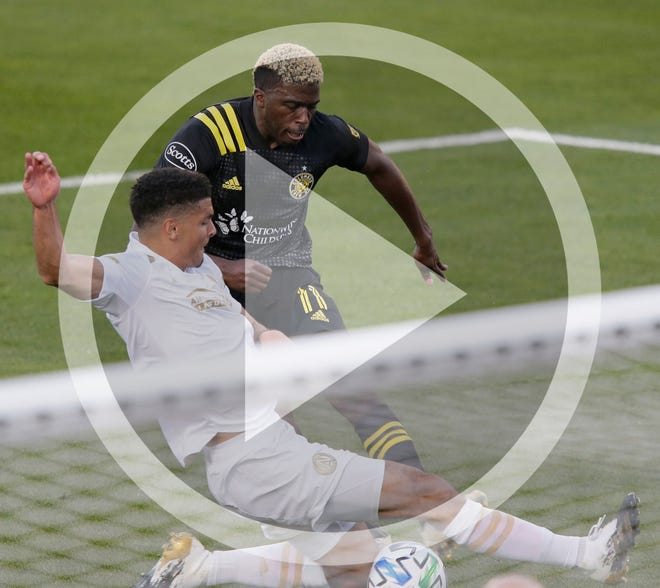 In this file photo, Forward Gyasi Zardes scores the Crew's second goal against Atlanta United defender Miles Robinson during the second half Sunday in Mapfre Stadium.