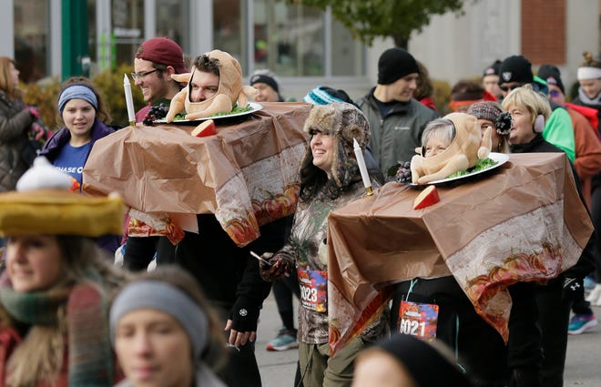 Participants are dressed as Thanksgiving tables during a previous Chase Columbus Turkey Trot. Like many running events, this year's race will be virtual.