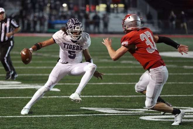 "Garner Wallace had what coach Jay Sharrett described as the ""almost-perfect Pickerington Central quarterback"" game in a Division I state semifinal against Mentor last week."