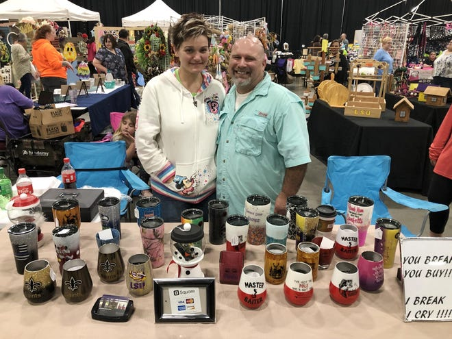Celeste and Don Jones are shown with their cups and insulated coffee mugs with custom-designed epoxy exteriors at their booth at the Craftin' Cajuns Craft Show and Marketplace at the Houma-Terrebonne Civic Center in 2019. This year's event is Saturday.