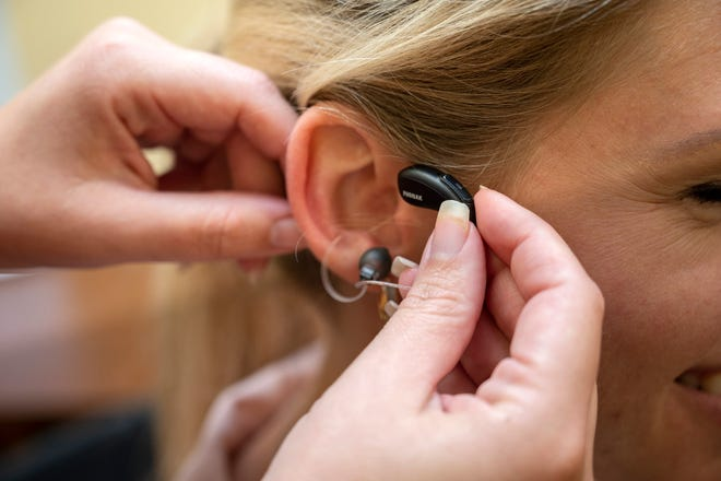 One lucky person will receive a pair of new state-of-the-art hearing aid and fitting for free and just in time for Christmas by Dr. Kristen Weinbaum, owner of Precision Hearing in Clermont. [Cindy Peterson/Correspondent]