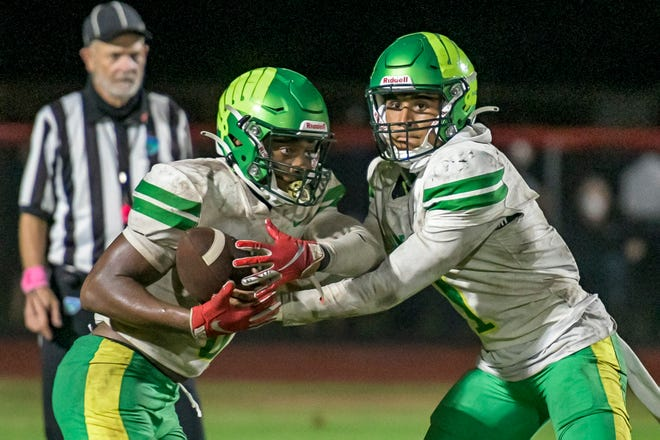 Lake Minneola's Robbie Sanders (1) hands off to Sadarius Walker (5) against South Sumter on Oct. 23 in Bushnell. Lake Minneola beat the Raiders 21-13. This week, Lake Minneola plays Land O'Lakes and South Sumter plays Palatka in the FHSAA playoffs[PAUL RYAN / CORRESPONDENT]