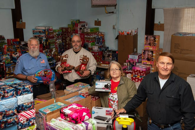 Some volunteers from last year's Guernsey County Secret Santa program included Gerry Shaffer, Paula Snyder, Dale Lyons, and John Davis. This year's program kicks off on Monday, but will be a little different because of COVID.