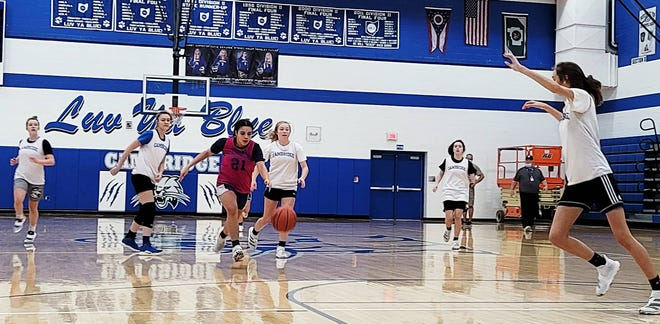 Cambridge High players run through a practice session on the Gene Ford Gymnasium court on Wednesday morning in preparation for the upcoming basketball season. Veteran CHS head coach Dan Linscott will again lead his Lady Bobcats on the hardwood this season.