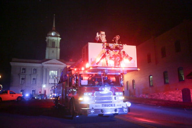 Santa Claus and Mrs. Claus ride on a Columbia Fire and Rescue engine down East 7th Street marking the end of the Columbia Main Street Christmas Parade on Monday, Dec. 2, 2019. (Staff photo by Mike Christen)