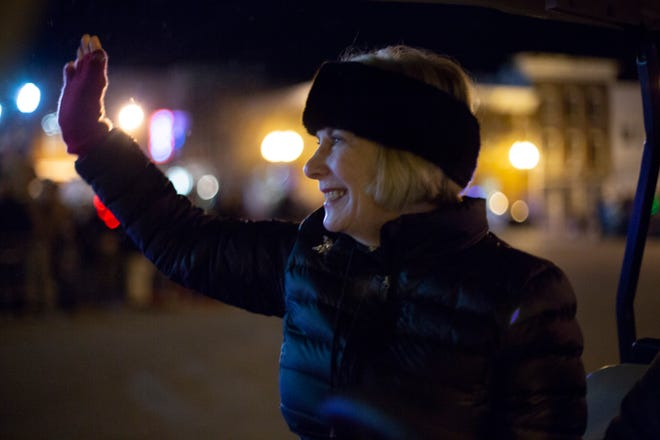 Kristi Martin, executive director of Columbia Main Street, waves at participants in the  Columbia Main Street Christmas Parade on Monday, Dec. 3, 2018. (Staff photo by Mike Christen)