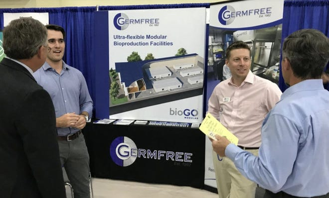 """Germfree Labs set up this display at the Volusia Manufacturers Association's """"We Make It Here"""" Manufacturers Showcase event at Father Lopez High School in Daytona Beach on Oct. 18, 2018. The display shows examples of the mobile and modular biosafety labs that the Ormond Beach company produces."""
