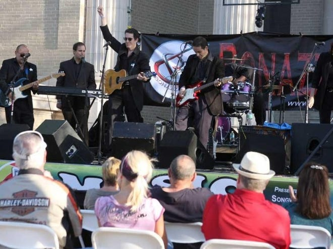 The Bonazzoli Band plays a set in front of the historic courthouse on Indiana Avenue during the annual music festival DeLandapalooza in 2013.