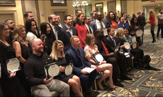 """Honorees at The Daytona Beach News-Journal's Volusia-Flagler """"40 Under Forty"""" awards event in March 2019 gather for a group photo at The Shores Resort & Spa in Daytona Beach Shores. Nominations are now being accepted for next year's event that will be held on March 12, 2021 at The 500 Club at Daytona International Speedway."""