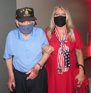 Vietnam veteran George Bertish and Marlene Peacock attend the Veterans Day ceremony held at the Flagler Auditorium.