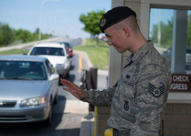 A file photo of Staff Sgt. Christopher Steeves, security forces response force leader 512th Airlift Wing, as he waves goodbye to drivers at a security gate at Dover Air Force Base. People can expect delays or closures at the gates Nov. 16-20 due to a base-wide training exercise.