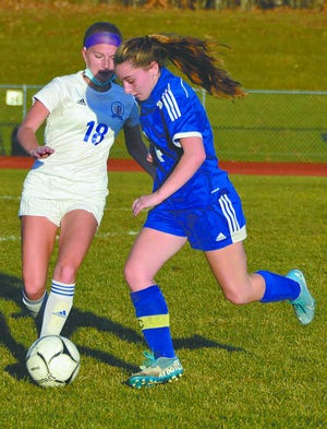 Dolgeville's Rylee Lamphere and Poland's Ava Malin (18) chase down a ball during Tuesday's soccer contest in Dolgeville.
