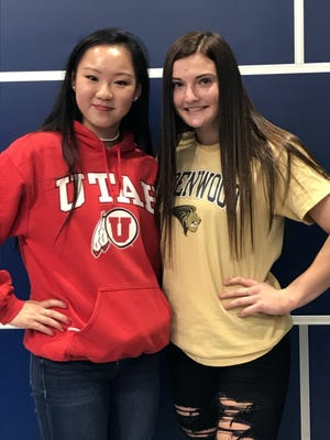 Olympic gymnastics hopeful Kara Eaker, left, poses with Grain Valley High School classmate and gymnast Carley Scott, on National Signing Day at the high school. Eaker signed with Division I Utah while Scott signed with Division II Lindenwood University.