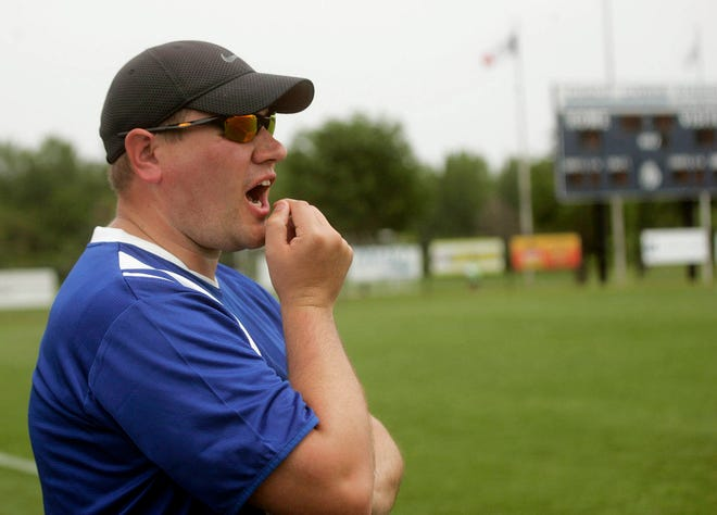 Danville-New London head coach Ted Kuechmann shouts instructions to the players against Dyersville Beckman in the first round of the Class 1A State Soccer Championship June 4, 2015 at the Cownie Soccer Complex in Des Moines.