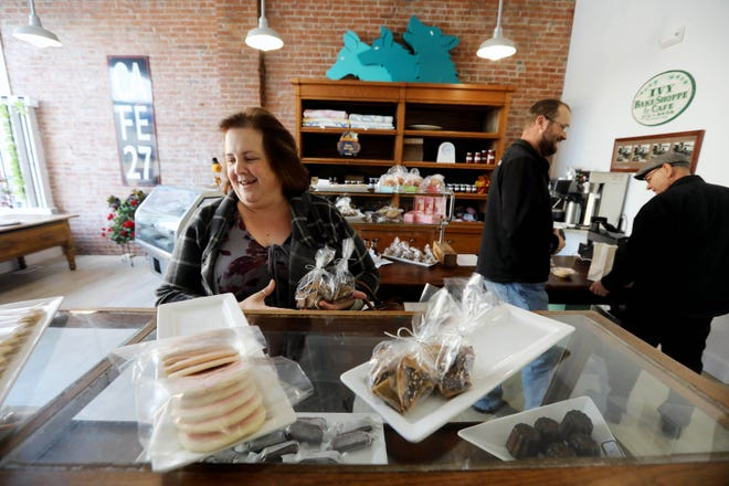 Lisa Lilienthal picks up some treats at The Collective Food Hub kitchen Oct. 31, 2019, at 805 Jefferson St. in downtown Burlington. The Collective Food Hub, featuring Gerst Family Gardens, will be open from 2 to 6 p.m. Thursday.