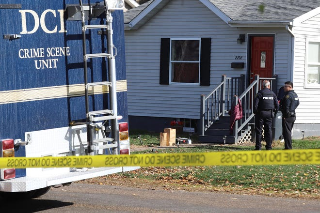 Burlington Police and Iowa Division of Criminal Investigation investigate outside the home of a shooting Thursday Nov. 12 at 2252 S. 10th St. in Burlington. One person was killed and another injured late Wednesday in a shooting that occurred about 10 p.m. Wednesday in the home.