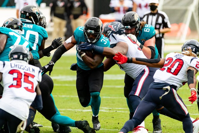 Jaguars RB James Robinson breaks though the defense in the third quarter against the Houston Texans. Matt Pendleton/Special to the Times-Union