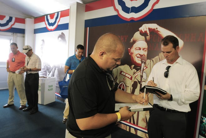 Charles Allen from Orange Park and David Rains from Jacksonville fill out paperwork for Lockheed Martin during a 2012 Military and Veterans Job Fair. A virtual career fair for veterans will be Nov. 19.