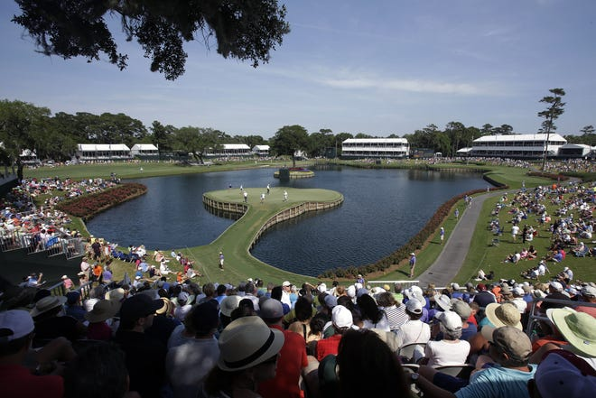 The 17th hole of the TPC Sawgrass Players Stadium Course will still be a popular spot for The Players Championship on March 11-14. But there won't be nearly as many fans because of COVID-19 protocols.