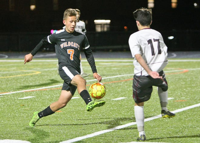 After five years as a starter on the Gardner High boys' varsity soccer team, senior midfielder Rigo Ruiz, shown playing the ball in front of an Ayer-Shirley defender in a game from last year, hopes to play at the collegiate level next year.