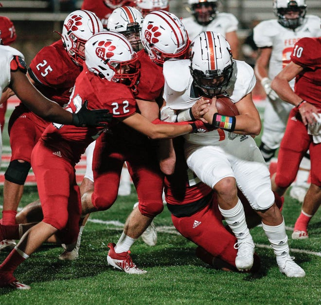 Members of the Glen Rose defense gang up for the tackle against a Ferris ball carrier.