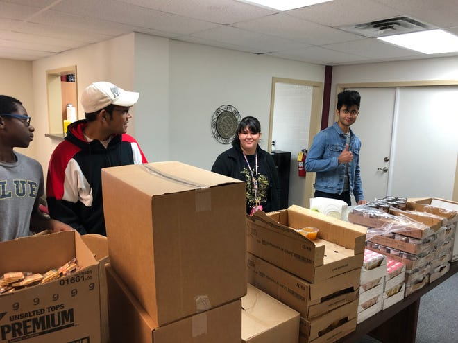 Austin College students help package food for Meals on Wheels recently