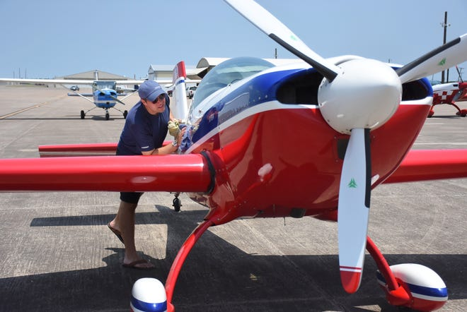 Erick McDaniel wipes down a Pitts 200 plane at the 2018 Lone Star Aerobatic Championship at North Texas Regional Airport Perrin Field. Organizers for the contest hope to return to NTRA for the 2021 contest, the first held locally since 2018.