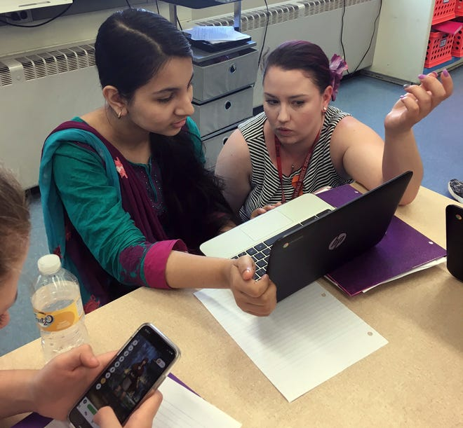 Technology has changed the way we live, so it's importans for parents need to be aware of the pitfalls and benefits of kids using social media. In this AP file photo, teacher Gianna Gurga, right, talks with student Maisha Chowdhury Jabia in a class at Dag Hammarskjold Middle School in Wallingford, Conn.