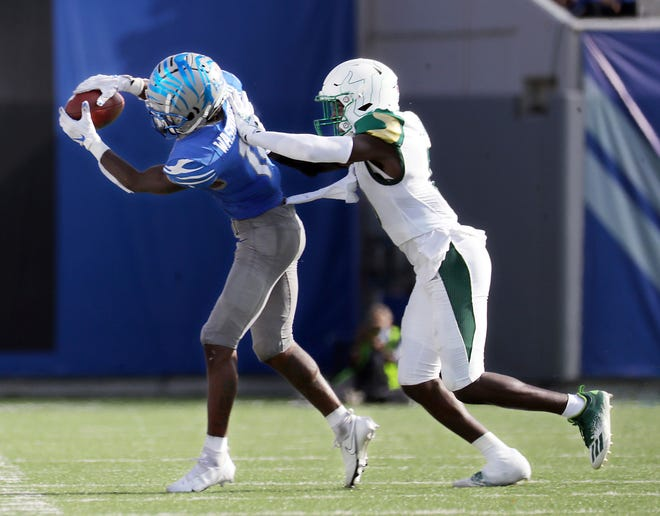 Memphis receiver Tahj Washington (18) catches a pass against South Florida on Saturday.