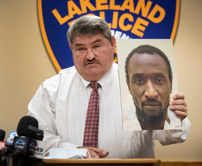 Lakeland Assistant Chief of Police Sam Taylor holds up a photo of Marcelle Jerrill Waldon who was arrested and charged with 10 felony counts in the murders of former city commissioner Edie Yates and her husband David Henderson during a press conference at LPD headquarters on Thursday. The couple were found brutally stabbed to death in their Lake Morton Drive home Tuesday night.