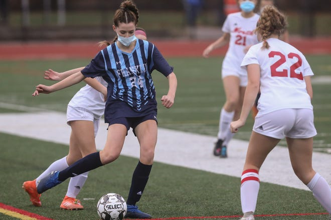 Franklin senior captain Bridgette Ginley passes the ball during the girls soccer game against North Attleborough at Franklin High School on Wednesday.