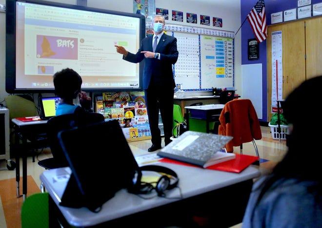 Gov. Charlie Baker visits Carlisle Public Schools last month. [Lane Turner/Globe Staff]