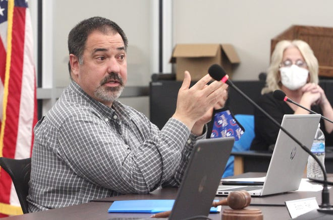 Moberly Public Schools Superintendent Dr. Tim Roling explains some agenda items Tuesday to school board members a meeting held at the high school. The district is considering to place a bond issue on the April 2021 election ballot that would not increase taxes.