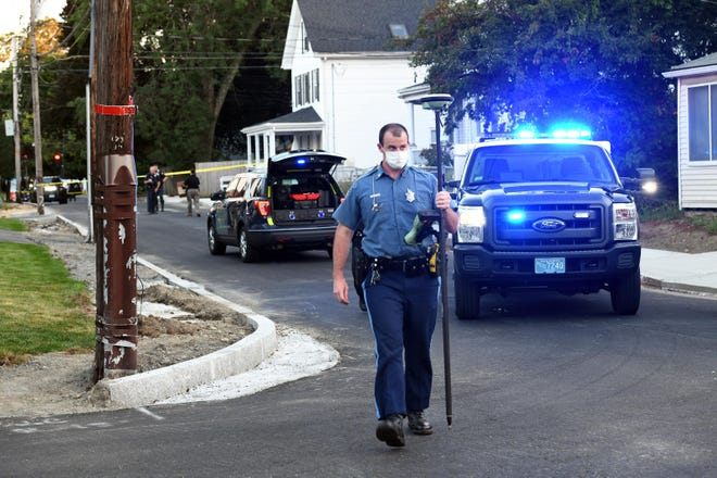 Police investigate the scene on Aug. 18, 2020, after a hit-and-run crash on Washington Avenue in Natick. On the same day the woman struck in the incident underwent her 10th surgery, the teen boy who was responsible had his case resolved in juvenile court.   [Daily News File Photo]