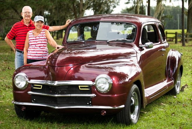 Bill and Susan DuVall post by their '47 Plymouth Custom coupe last week. Bill purchased the car six years ago and took four years to restore it.