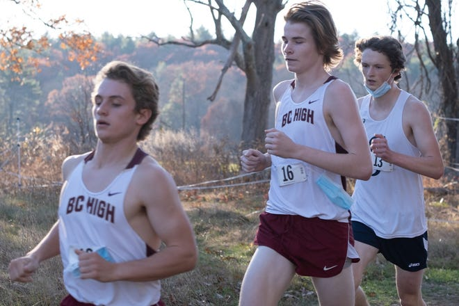 BC High runners Joe Chase of Hingham (in front) and Owen Duggan of Weymouth (No. 16) compete at the Catholic Conference Classic earlier this week.