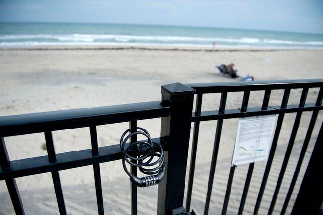 The beach access gate at Dunbar Road in Palm Beach is locked at nights. MEGHAN MCCARTHY/PALM BEACH DAILY NEWS