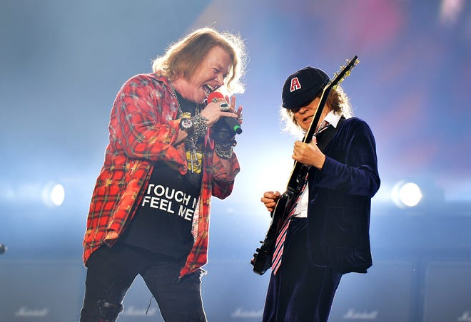 "Axl Rose and Angus Young of the band AC/DC perform at the Olympic Stadium in London in 2016. The band released a new album, ""Power Up,"" Friday."