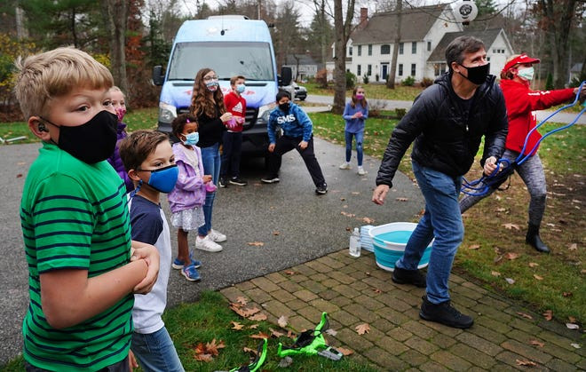 """Aidan Carter 12 of Stratham and his friends enjoy water balloon games with Diary of a Wimpy Kid author Jeff Kinney, left, while on tour Thursday for his newest book, """"The Deep End."""""""