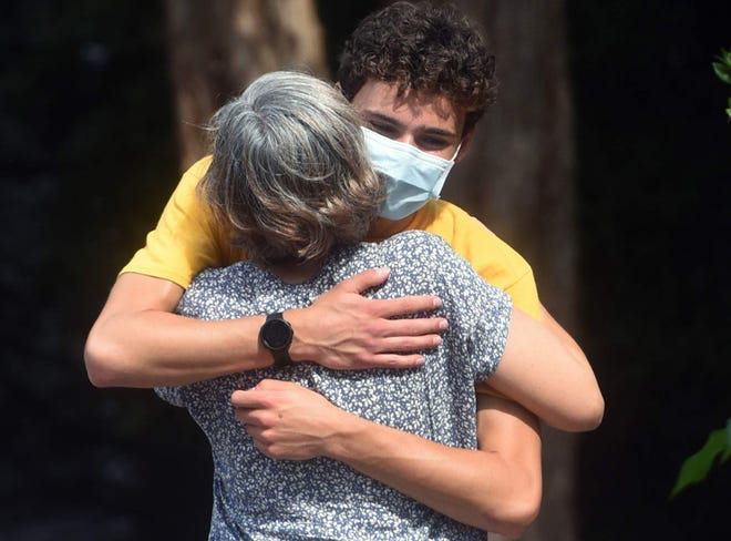 Paige Wyatt hugs her son Seth goodbye at the University of New Hampshire as students arrived in late August. With the end of on-campus learning approaching Nov. 20, UNH officials warn with a surging number of COVID-19 cases students should consider sheltering in place for the final days.