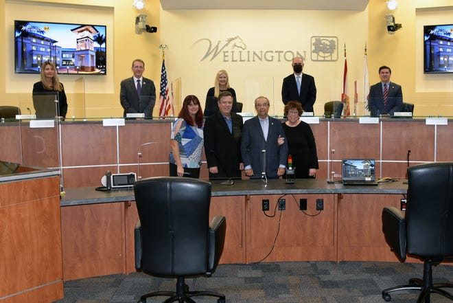 Dr. Carmine Priore, front row second from right, will have his name added to Wellington's Founders Plaque in Village Hall.