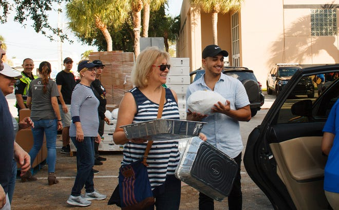 Volunteers from Boca Helping Hands will be distributing boxes containing the fixings for a Thanksgiving meal at four locations this year.