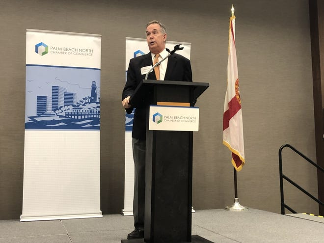 Former state legislator Jeff Atwater addresses a meeting of the Palm Beach North Chamber of Commerce Thursday in Palm Beach Gardens. Atwater discussed the 2020 election and how the results potentially could impact Florida.