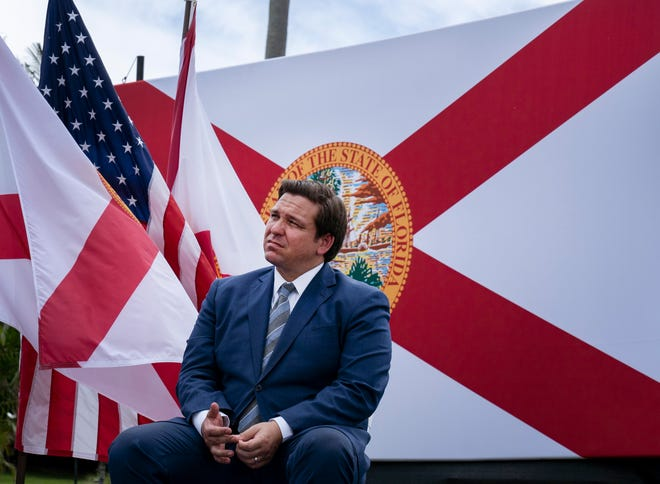 Florida Governor Ron DeSantis listens to President Donald Trump speak at the Jupiter Inlet Lighthouse and Museum in Jupiter, Florida on Tuesday, Sept. 8, 2020. (Greg Lovett /palmbeachpost.com]