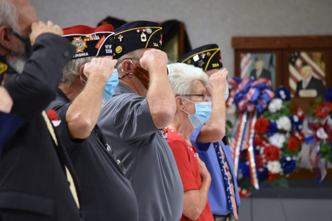 Veterans salute the flag at American Legion Post 284's Veterans Day ceremony on Nov. 11, 2020.
