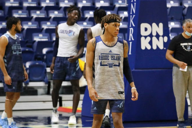 URI guard Fatts Russell participates in a practice at the Ryan Center.