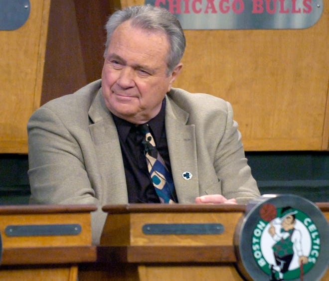 Tommy Heinsohn listens as the Celtics are awarded the number 5 pick in the 2007 NBA draft lottery in Secaucus, N.J. The legendary former player, coach and broadcaster died this week at the age of 86.